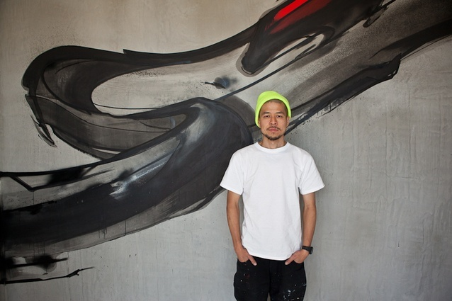 Graffiti artist Jun Inoue with his installation at Melbourne's new Trocadero brasserie.