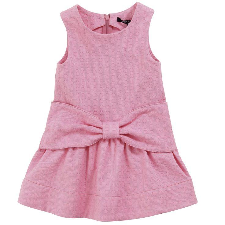 Robe courte à pois stretch rose bonbon (non doublée). Sans manche. Zip invisible dans le dos. Grand nœud appliqué sur la taille.