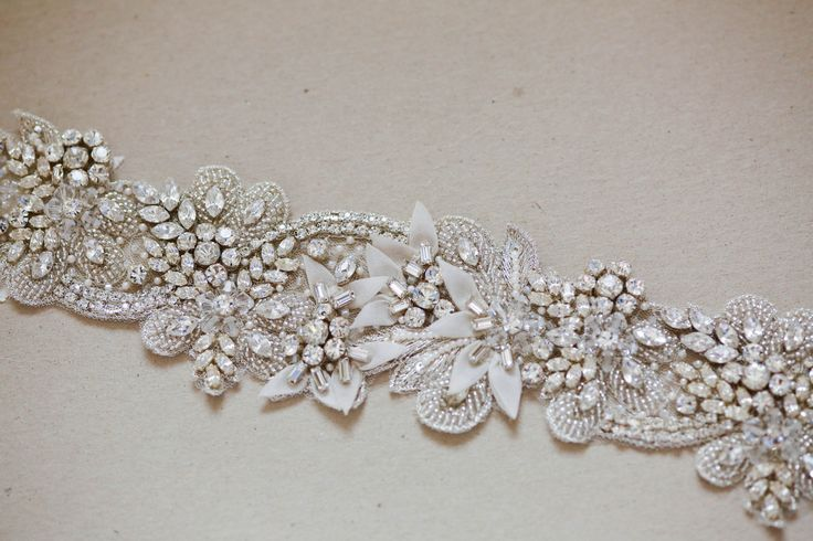 Bridal belt - Ophelia | MillieIcaro $258.00  Bridal sashes and belts - Ophelia  Colors : Offwhite, ivory and silver Length = 12 to 13 inches Width = 2 inches approximately