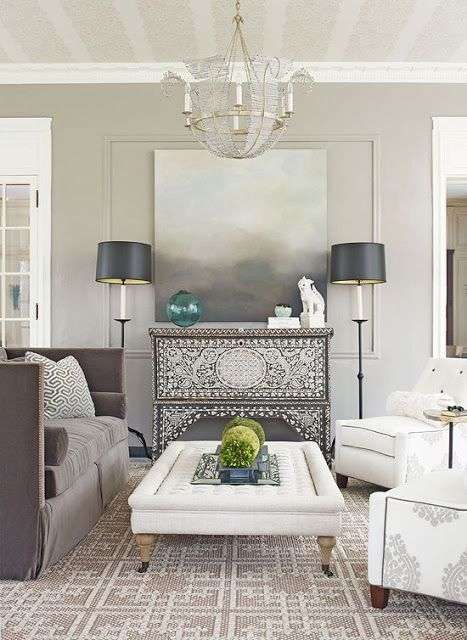 Pale gray living room walls with white trim