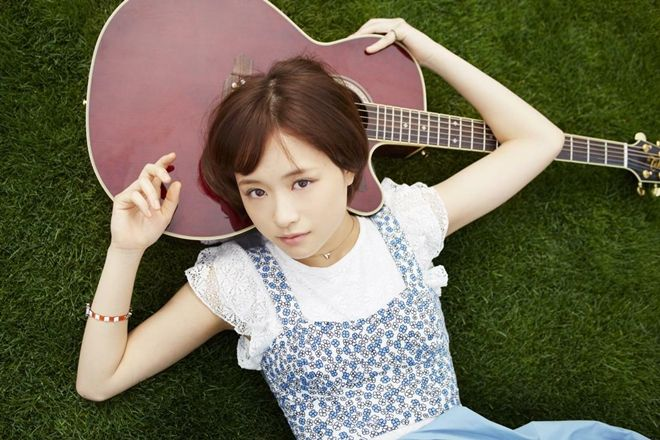 Posing with a guitar