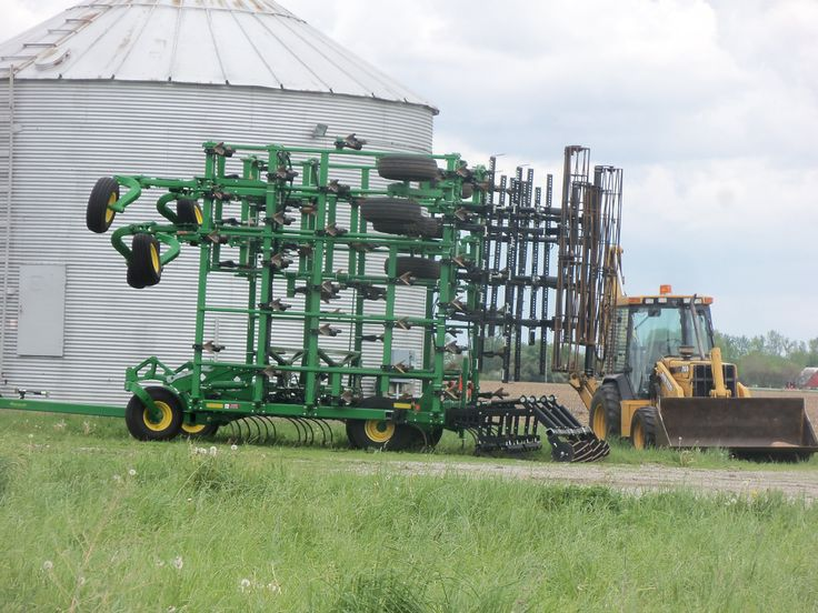 Either a John Deere 2210 or 2310 field cultivator hooked to 9560RT