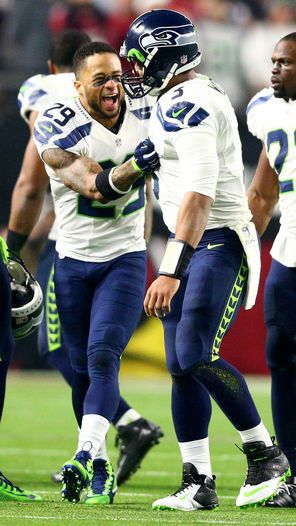 Seahawks safety Earl Thomas congratulates Seahawks quarterback Russell Wilson after Seahawks tight end Luke Willson scored on an 80-yard touchdown  pass from Russell Wilson against the Arizona Cardinals in December.