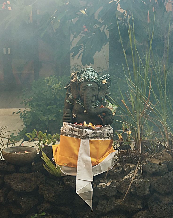 #Ganesha sits #welcoming! In #Bali, a proper home, place of gathering, or place of stay should contain this presence upon entry. #Symbolizing #knowledge, #wisdom, and welcomeness, Ganesha is said to #DispelEvil and depose #NegativeEnergy #Seminyak