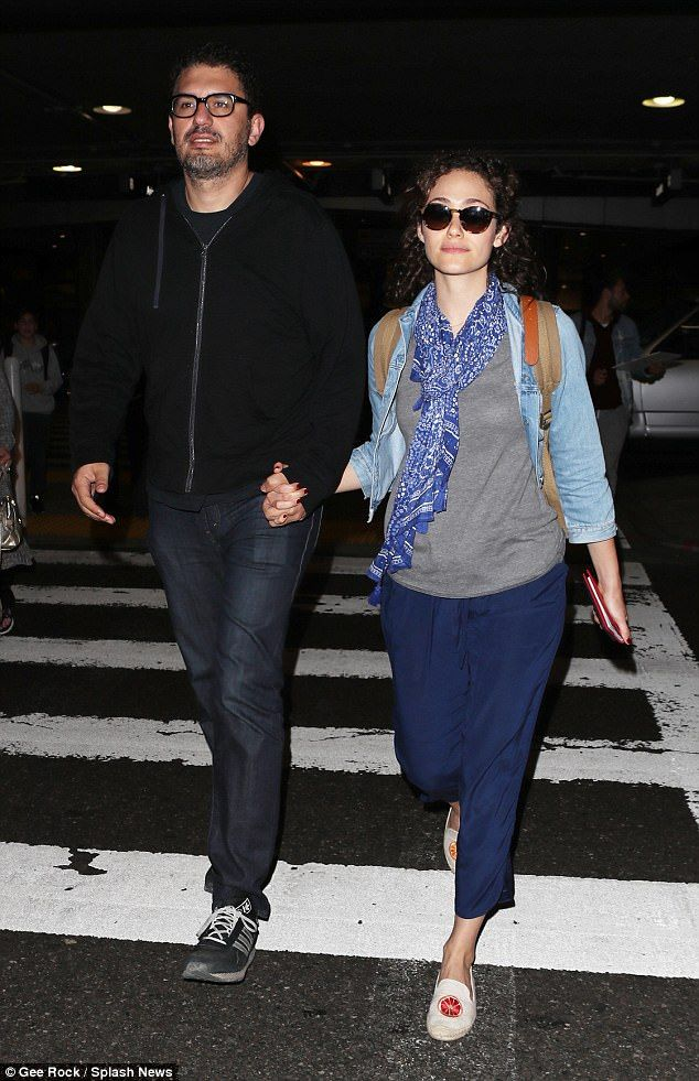 Loved up:Emmy Rossum, 31, and husband Sam Esmail, 40, looked every inch the loved up couple as they were spotted at LAX on Monday