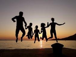 Fun at Sunset, Family Photo Shoot Jumping on the Beach - Avoya Travel Google+