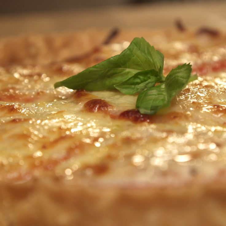 Katie Quinn teaches an easy, cheesy tomato pie recipe that's great for week nights and can be dressed up with toppings or kept simple - either way, there's no way of messing this up!