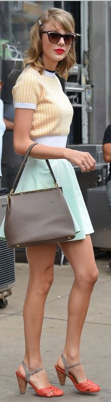 Who made  Taylor Swift's mint green skirt, brown handbag, sunglasses, yellow short sleeve print sweater, bobby pins, and sandals