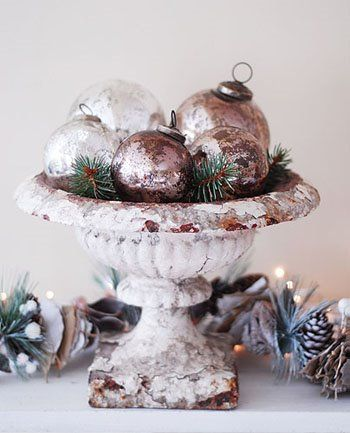 Display keepsake vintage Christmas balls that are too fragile or a little broken in an urn. A great way to remember Great Grandmother's tree.