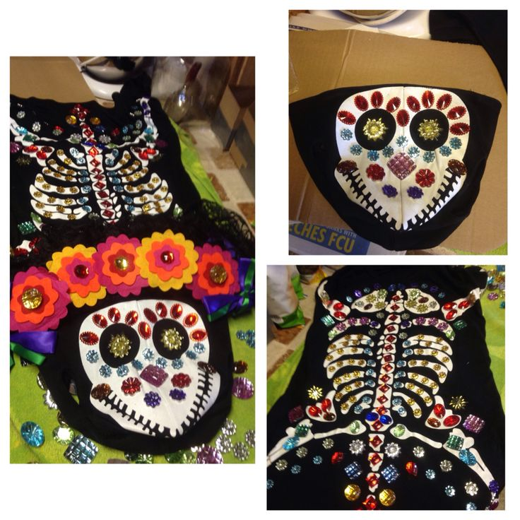 Award winning Dias de Los Muertos costume for medium/large size dog. Made from dog's skeleton costume embellished with rhinestones and felt flowers.