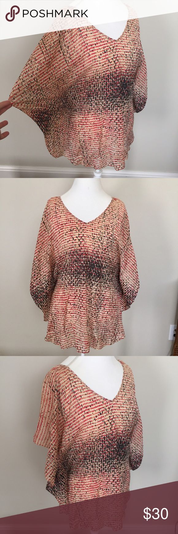 Anthropologie Lil Batwing Dolman Tunic Top Pretty multicolor printed Batwing Tunic Top by Lil from Anthropologie. Excellent condition with no flaws. Size 4 and fits like a true small. ❤No trades or holds. I accept reasonable offers. I only negotiate through the offer button. I do not model. 🚭🐩B3 Anthropologie Tops Tunics