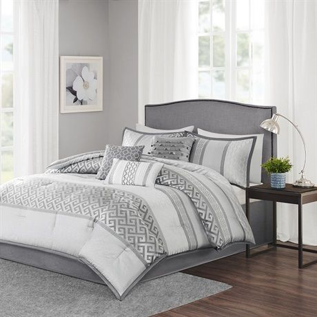 The Bennett Comforter Set provides a peaceful update to your bedroom with its soft shades of charcoal and silver. Several geometric prints adorn this collection working together in large and small stripes for an updated traditional look. Three decorative pillows use embroidery and fabric manipulation techniques for a cohesive look in your space.