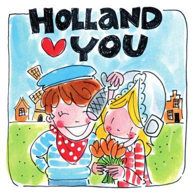 Gehuld in Nederlandse klederdracht in een weiland- Greetz