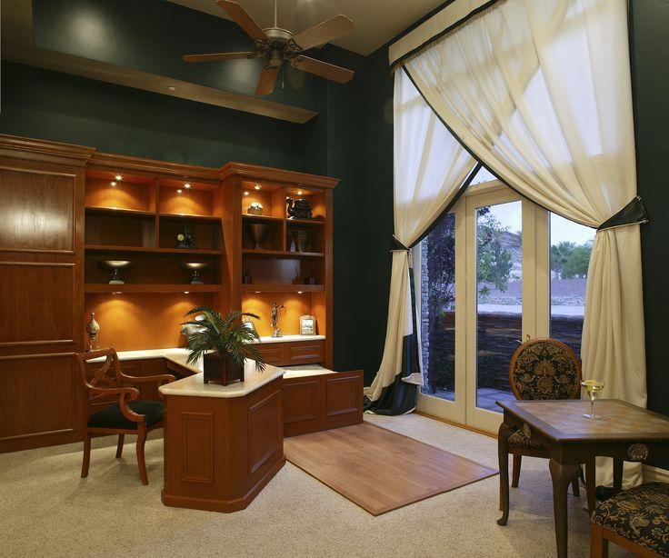 Neutral carpet was the perfect choice for these dark green painted walls! The carpet and warm lighting make this home office feel nice and cozy. See our carpet stain removal tips so you can keep yours floors looking spotless.