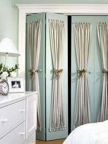 mount curtain rods and little curtains on the outside of your plain closet doors....how about mounting those doors on each side of the window like barn doors that slide open and closed...instant shutters? Hmm idea for living room