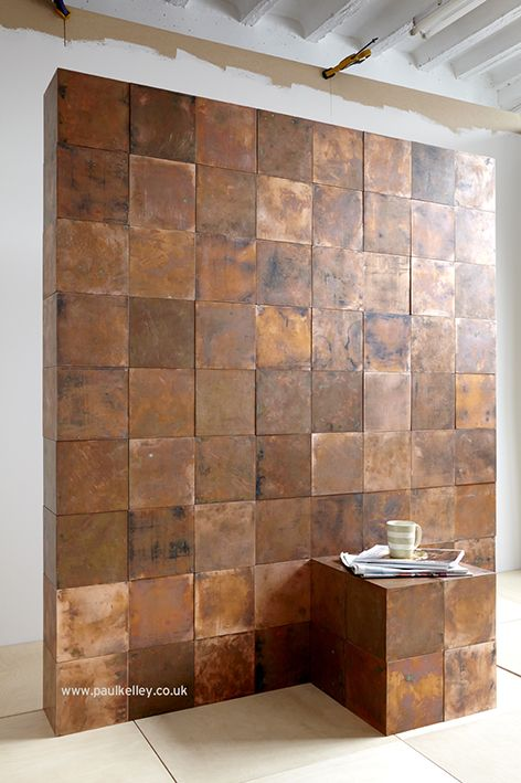 Copper walls! Create your own furniture, divide your room, build a bookcase, table or chairs or all of the above. The Bob system magnetic copper cubes can be made into whatever you wish.