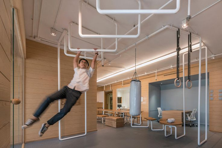 Putting the IT in fit, Inteltion follows the fashion of fitness with gymnast rings, punching bags, and ping-pong in the boardroom.