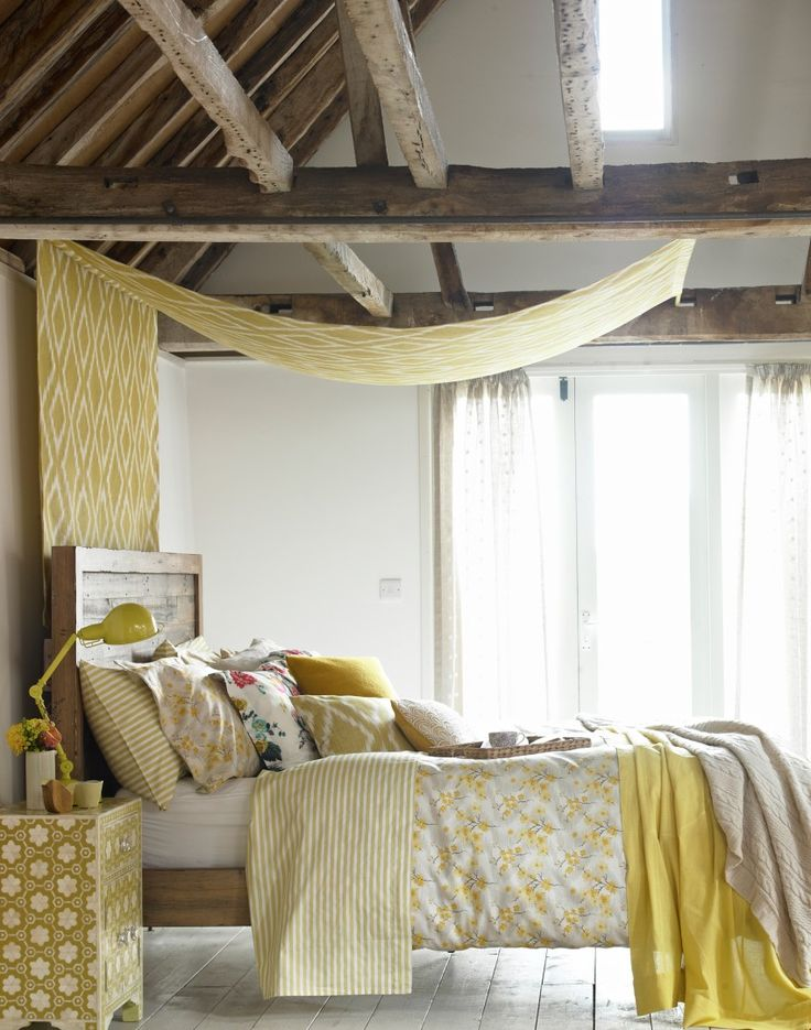 Country Bedroom with Exposed Beams and Bed Canopy