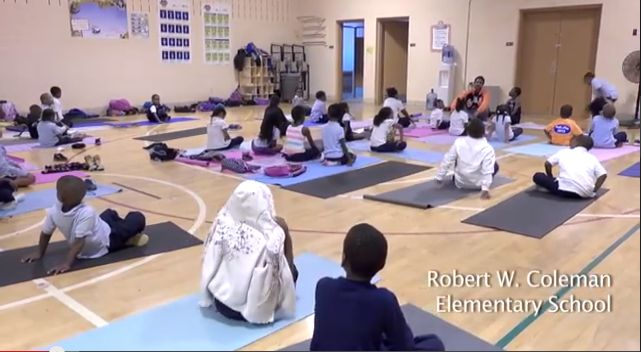 Children in one of Baltimore's toughest neighborhoods find calm and confidence with the help of three young men who teach them yoga and meditation.