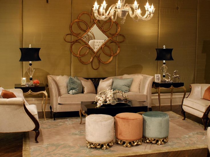 Gold silk covers the walls of this elegant living room