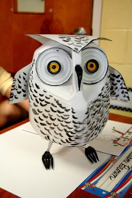 Snowy Owl made of recycled materials. The post also includes photos of lots of other ideas for making animals from recyclables. Family project idea for Earth Day?