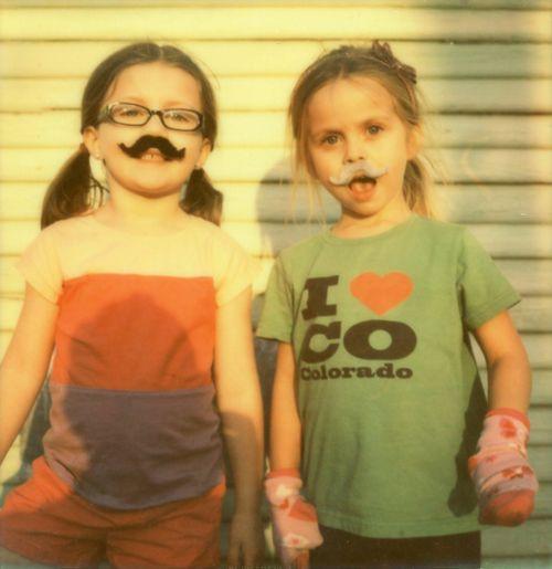 "Mackenzie and Olivia. Austin, TX.  Mackenzie: ""I like sprinkles on my ice cream.""  Olivia: ""Me too!""  Photo by Amber Byrne Mahoney."