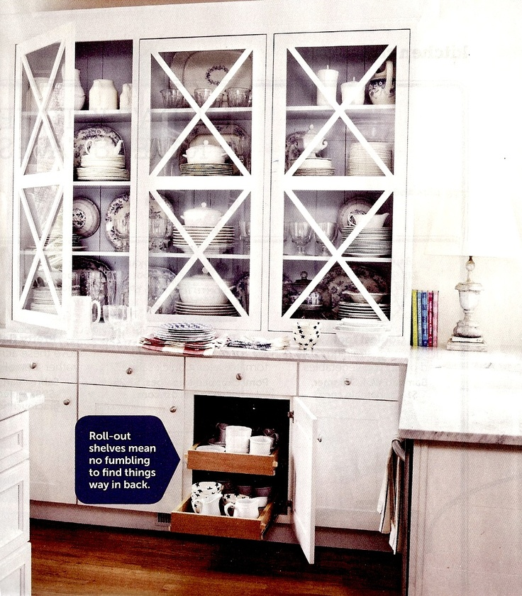 Open/glass cabinetry with a subtle pop of color is a good way to show off fancy china!