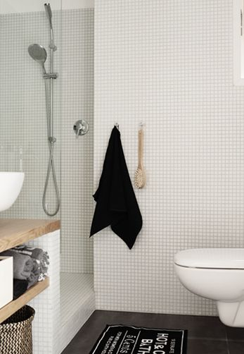 Black accessories up the chic factor to the bath. #blackisback #bathroom