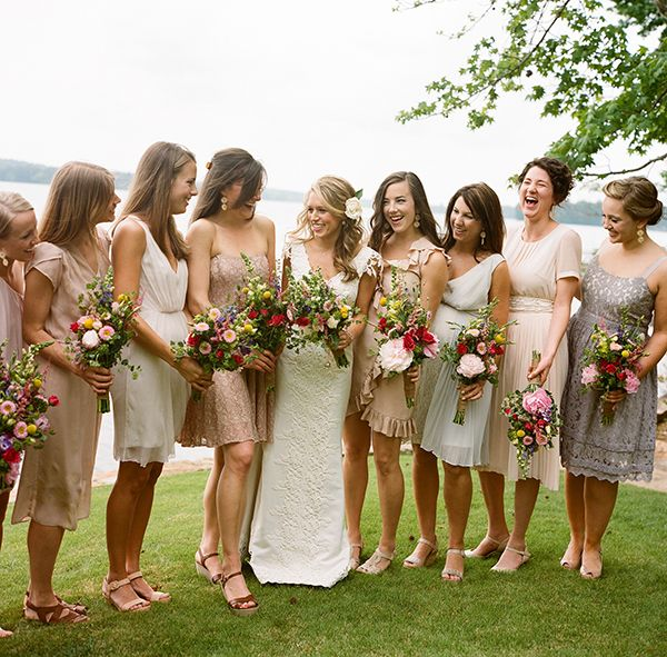 I love the bridesmaid dresses in neutrals. The bride just asked her bridesmaids to purchase a short dress in a neutral colour and left it to them. As a whole it looks great, and each bridesmaid was able to feel really comfortable because the dress was their choice. Image by Clark Brewer via Snippet & Ink