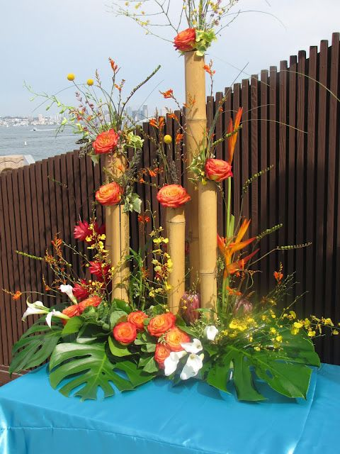 Tropical Inspired Centerpiece with bamboo and roses