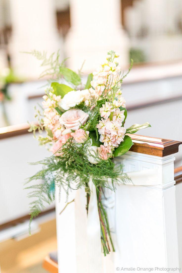 pew marker of peach stock, white majolik spray rose, rosita vendela rose, light pink mini carnations,lemon leaf, italian variegated pittosporum and fern is tied with cream satin ribbon.