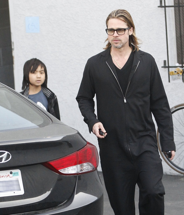 Not sure what's up with Brad Pitt's black jumpsuit in this shot, but his thick black specs are definitely rockin'!