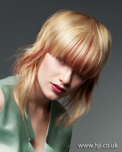 A Shoulder Length Blonde Style With Pink Panels Was