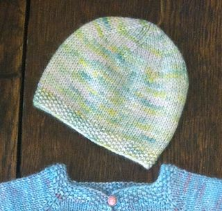 This easy baby hat is knitted flat and seamed at the side.  f2fdaa5a786