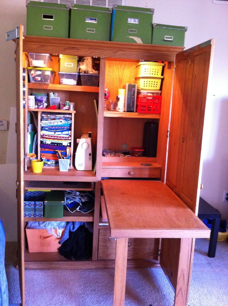 An old computer armoire turned into a craft storage complete with its own desk space!