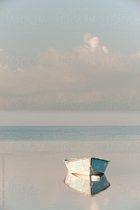 Row Boat reflected in Still Water by GaryRadler | Stocksy United