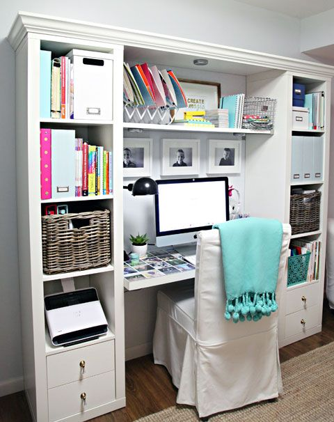 Expedit IKEA bookcase flanking desk area