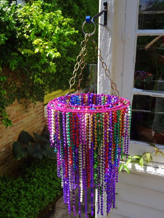 Mardi Gras beads chandelier - Use drying peg ring and old necklace beads and you have made your own beautiful colorful chandelier... for melissa