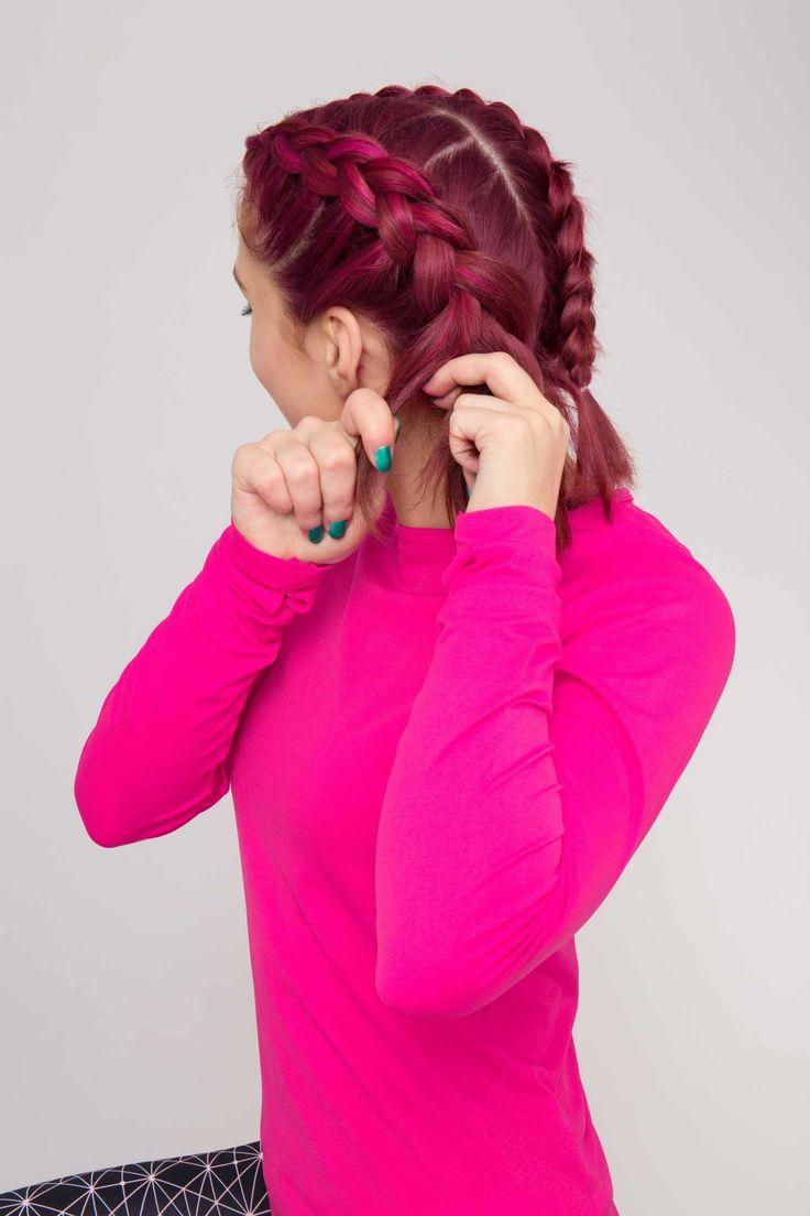 Boxer braids: A young woman parting her short pink hair plaiting a Dutch plait/cornrow/boxer braid #CornrowsShort