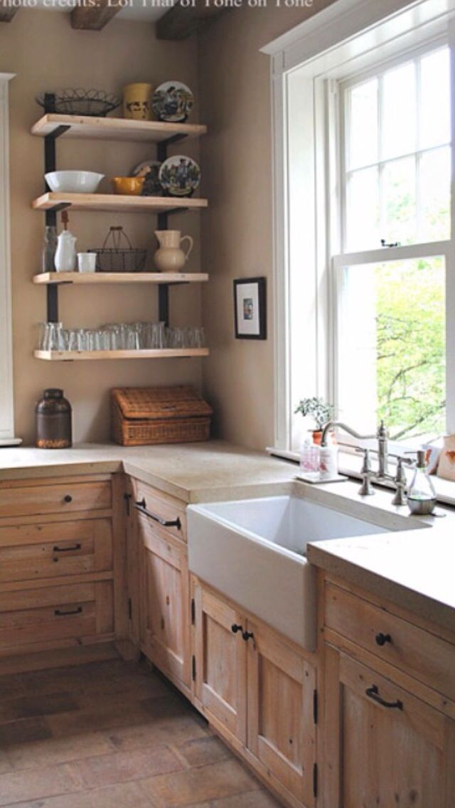 Limestone countertops. Love the cabinets