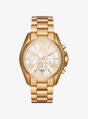 Exclusively Ours in the U.S. in Michael Kors stores and on michaelkors.com. We designed this oversize version of the Bradshaw watch in a classic gold-tone stainless steel with a pearlescent dial. Chronograph detailing lends function, while the Roman numeral time-stops add classic appeal.