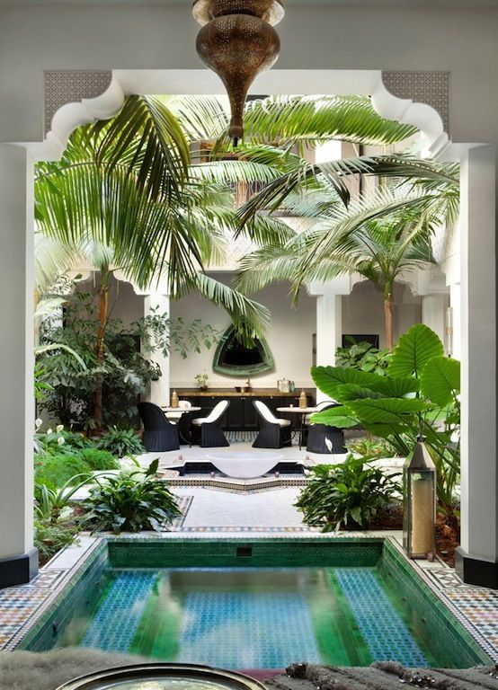 indoor courtyard pool surrounded by palms
