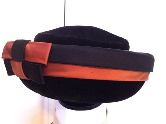 Hat Vintage Pill Box Art Deco Hat 1940's by ClearWaterDesignsbyK Https://clearwaterdesignsbyk.etsy.com Https://clearwaterdesigns.info This Vintage 1940's Art Deco Style Pill Box Hat is in perfect vintage condition! It is made by Ellen Heart & has it's original label. It has the classic Geometrical patterned design of the Art Deco Style on the front in Salmon & Black Satin. There are 2 rectangular shaped bows in the front that form this pattern. The rest of the hat is Black Velvet.