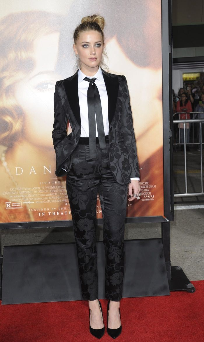 Amber Heard at the LA premiere of The Danish Girl wearing a Dolce & Gabbana pant suit