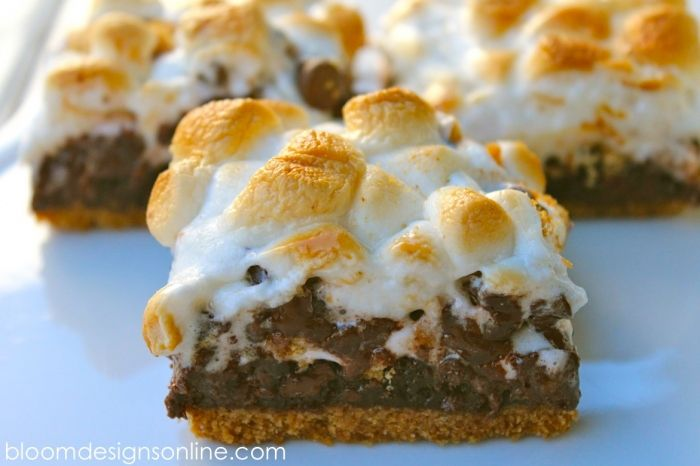 Hi Everyone. We are heading back to school and I am already wishing it was summer. I whipped up these brownie s'more bars to ease the transition back into our busy routine and to remind my kids that summer is right around the corner. We eat s'moreall summer long but when you can't be outside, these are a fantastic version of a favorite dessert. They