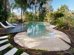 Concrete pool with beach entry.  Modern.