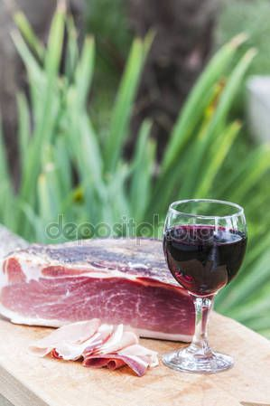 Italian speck with red wine — Stock Photo © carlotoffolo #148364111