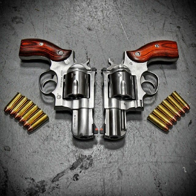 Double fist this. Twin @rugersofficial Redhawk 44 Magnum revolvers at @otbfirearms. Metal as fuck. #metalhead #badass #revolver #beastmode