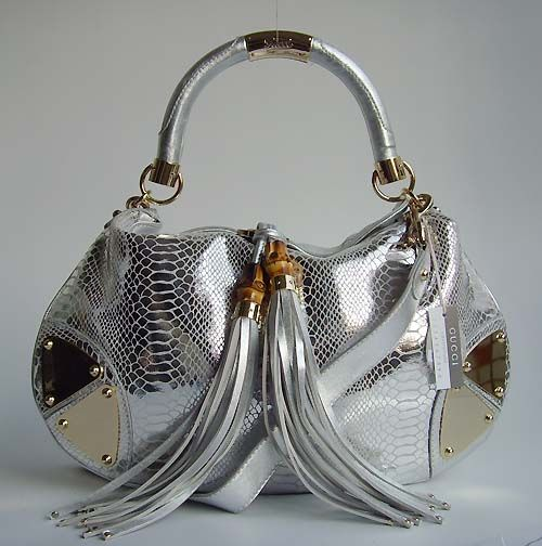 Gucci Silver Snake Handbag - before I had to pay for private school, this would have been MINE!