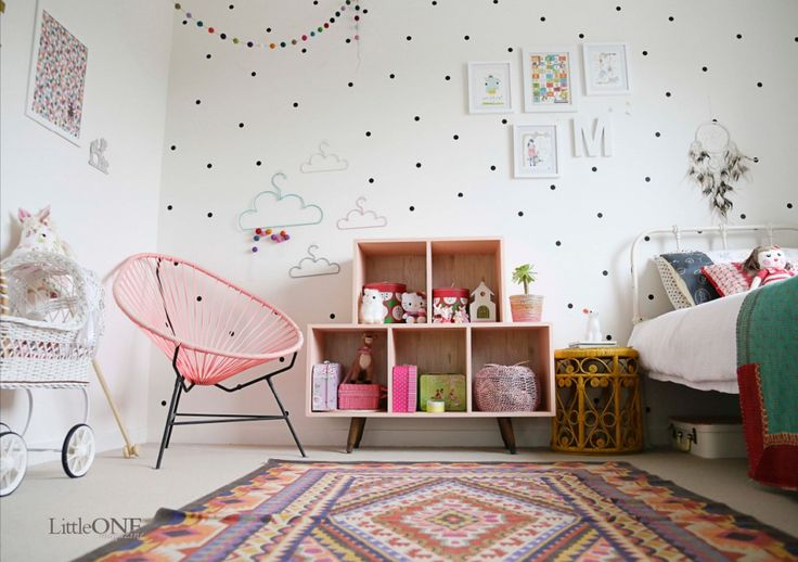 polka dot wall decals, pink acapulco chair, fun little girls room